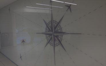 הדפסה על זכוכית בנמל תעופה, חיפוי זכוכית